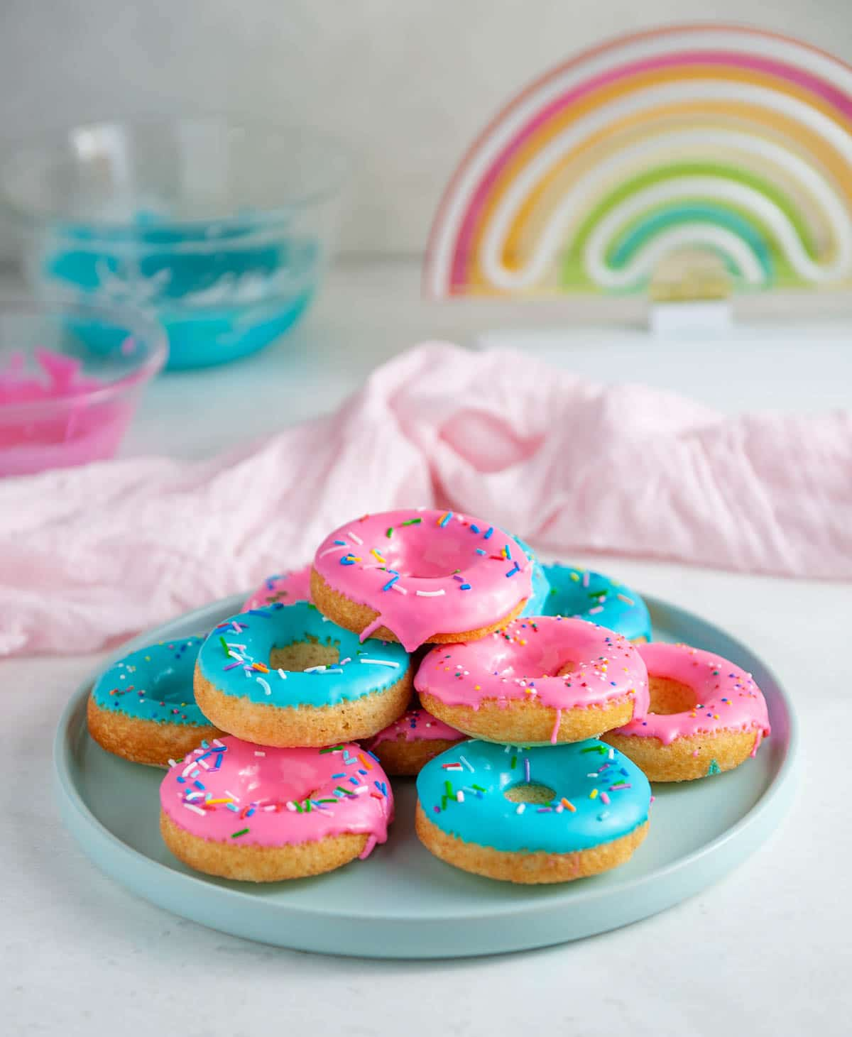 pink and blue donuts on a blue plate