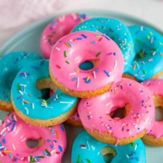 baked donuts with pink and blue glaze and sprinkles