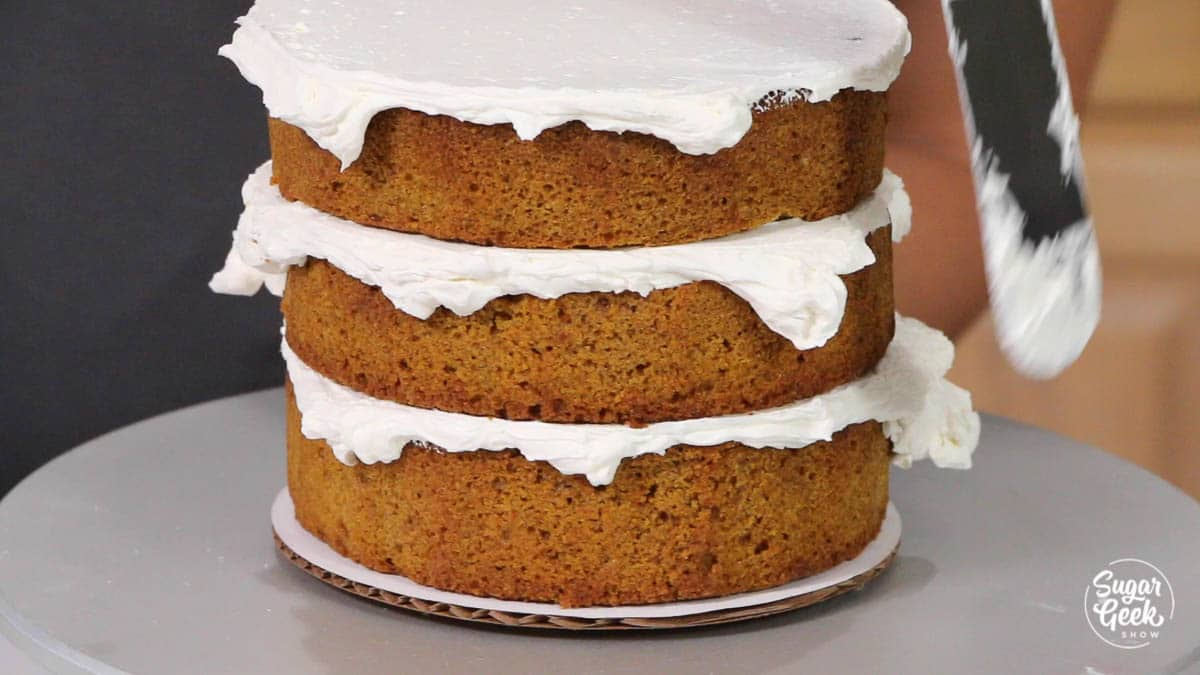 pumpkin cake stacked with buttercream