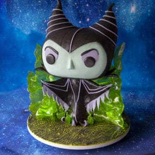 Sculpted cake that looks like a funko pop figurine in the likeness of Maleficent