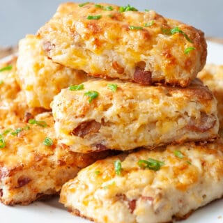 stack of bacon cheddar scones on a white plate