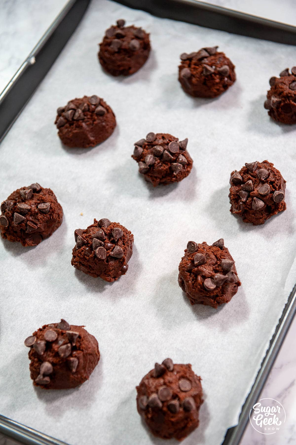 rolling double chocolate chip cookie dough into balls