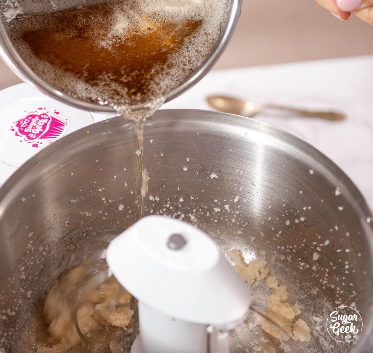streaming sugar syrup into mixing bowl