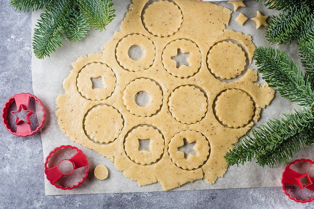 Linzer cookies being cut from dough shot from above