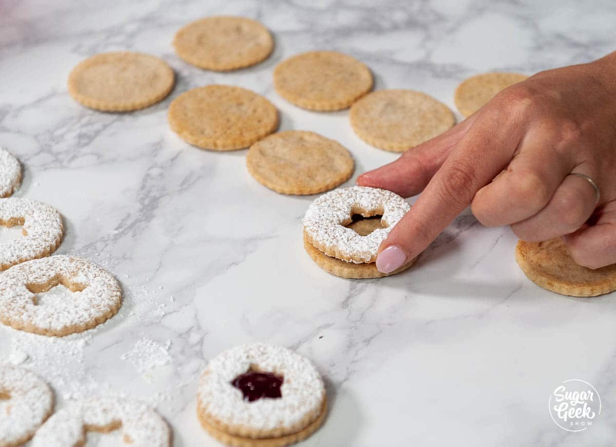 pressing linzer cookies together
