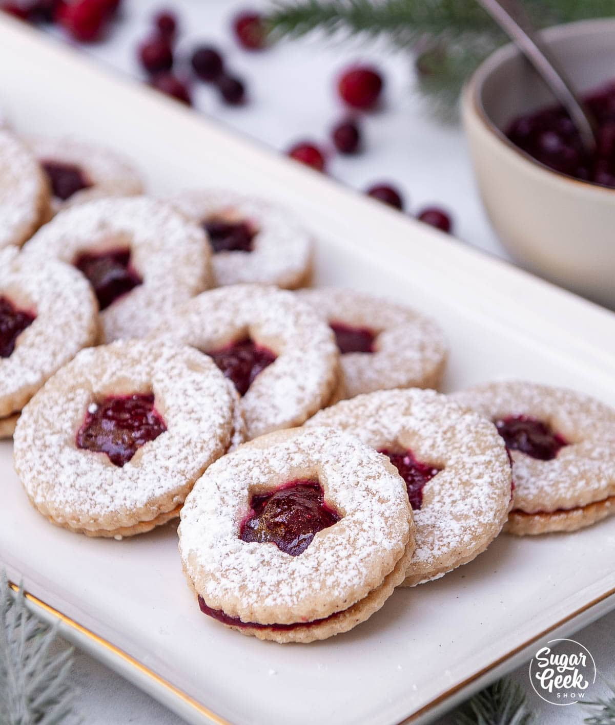 linzer cookies on a white plate