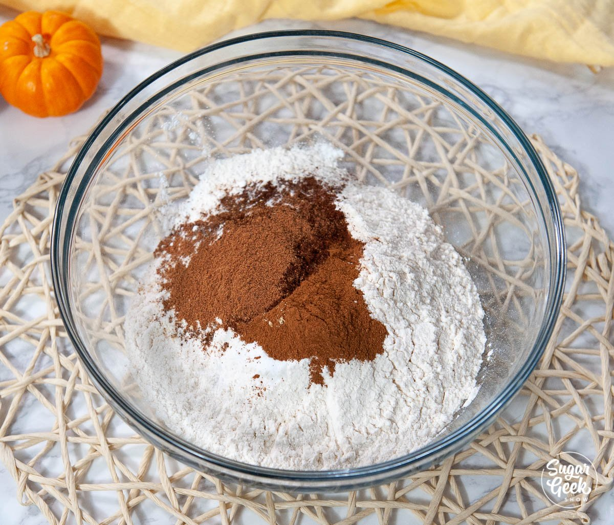 pumpkin spice cake ingredients in a clear bowl