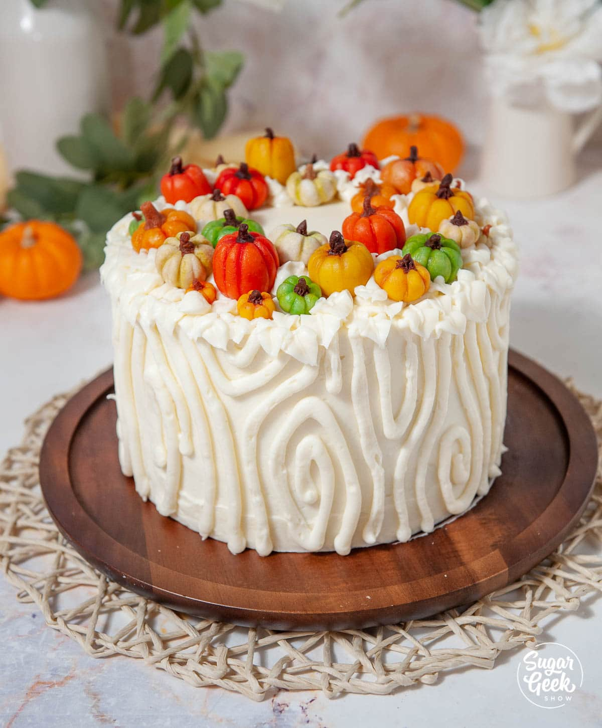 pumpkin spice cake with marzipan pumpkins on top