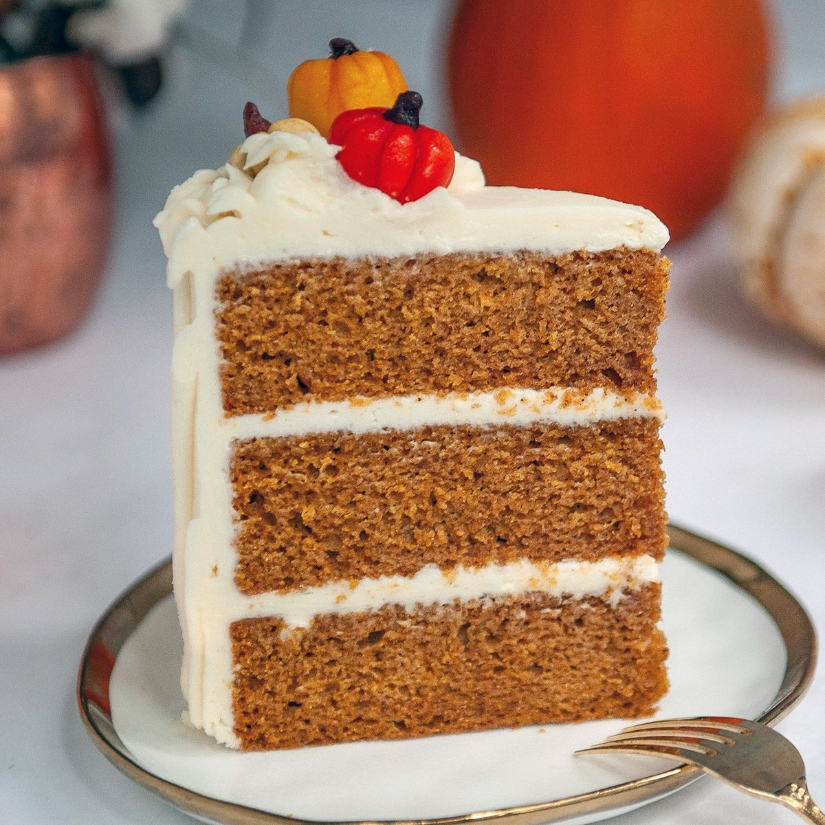 closeup of pumpkin spice cake on a white plate