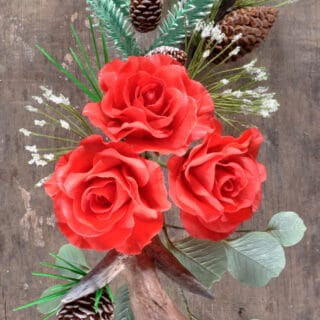 Sugar flowers arranged in a rustic holiday pattern