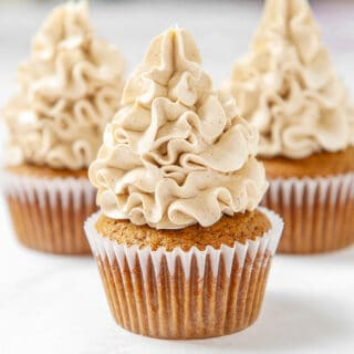 close up of brown sugar swiss meringue buttercream on a cupcake