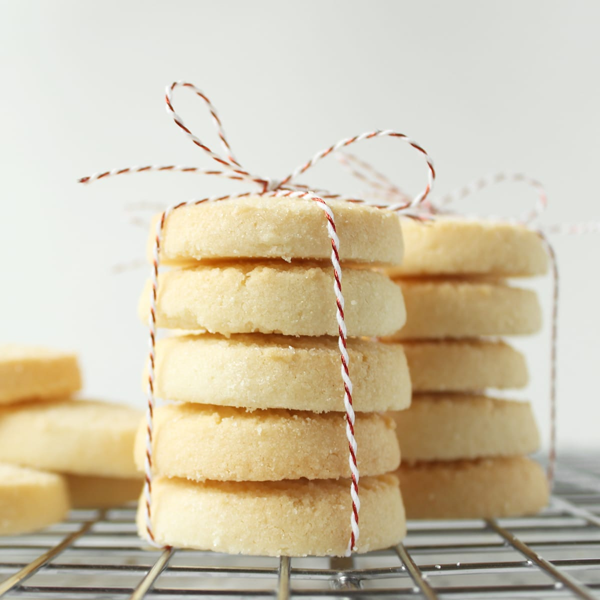 stack of lemon shortbread cookies tied with red and white twine