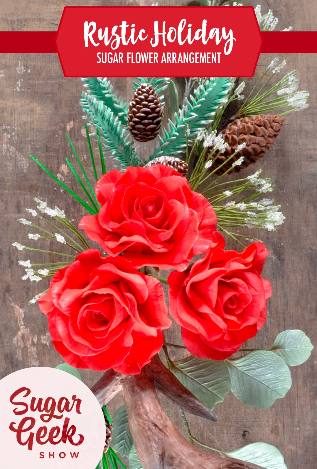 3 sugar flower roses, pine needles, edible pine cones and branches arranged in a rustic holiday pattern