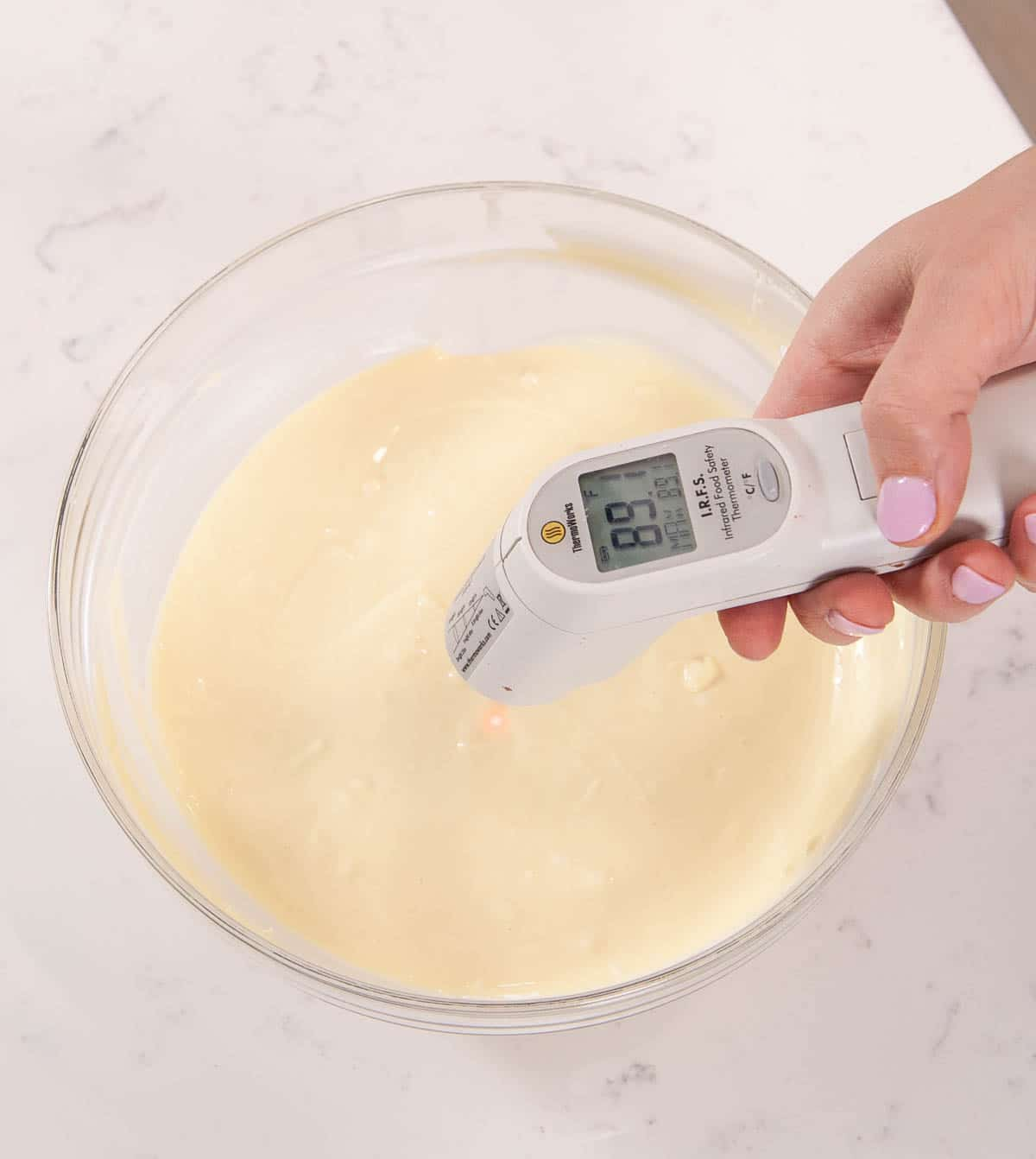 white thermometer over bowl of white chocolate