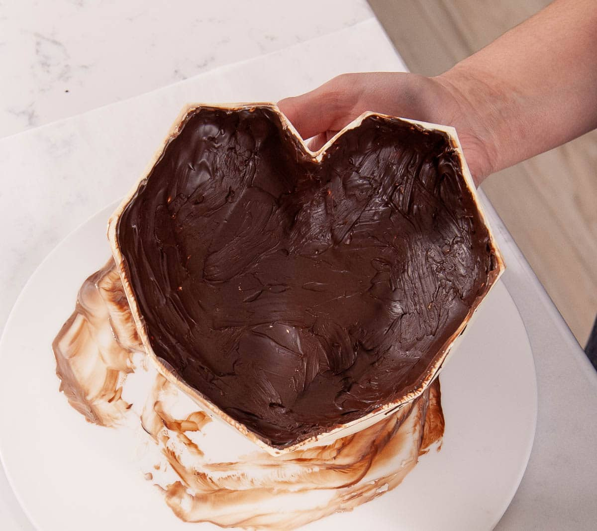 hand holding chocolate breakable heart