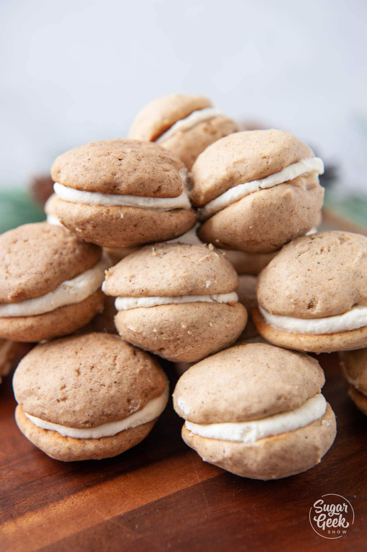 pile of chai whoopie pies on a wooden board
