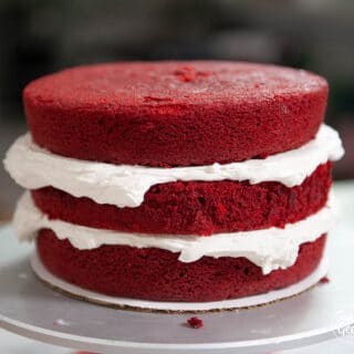 three layers of doctored red velvet cake with buttercream
