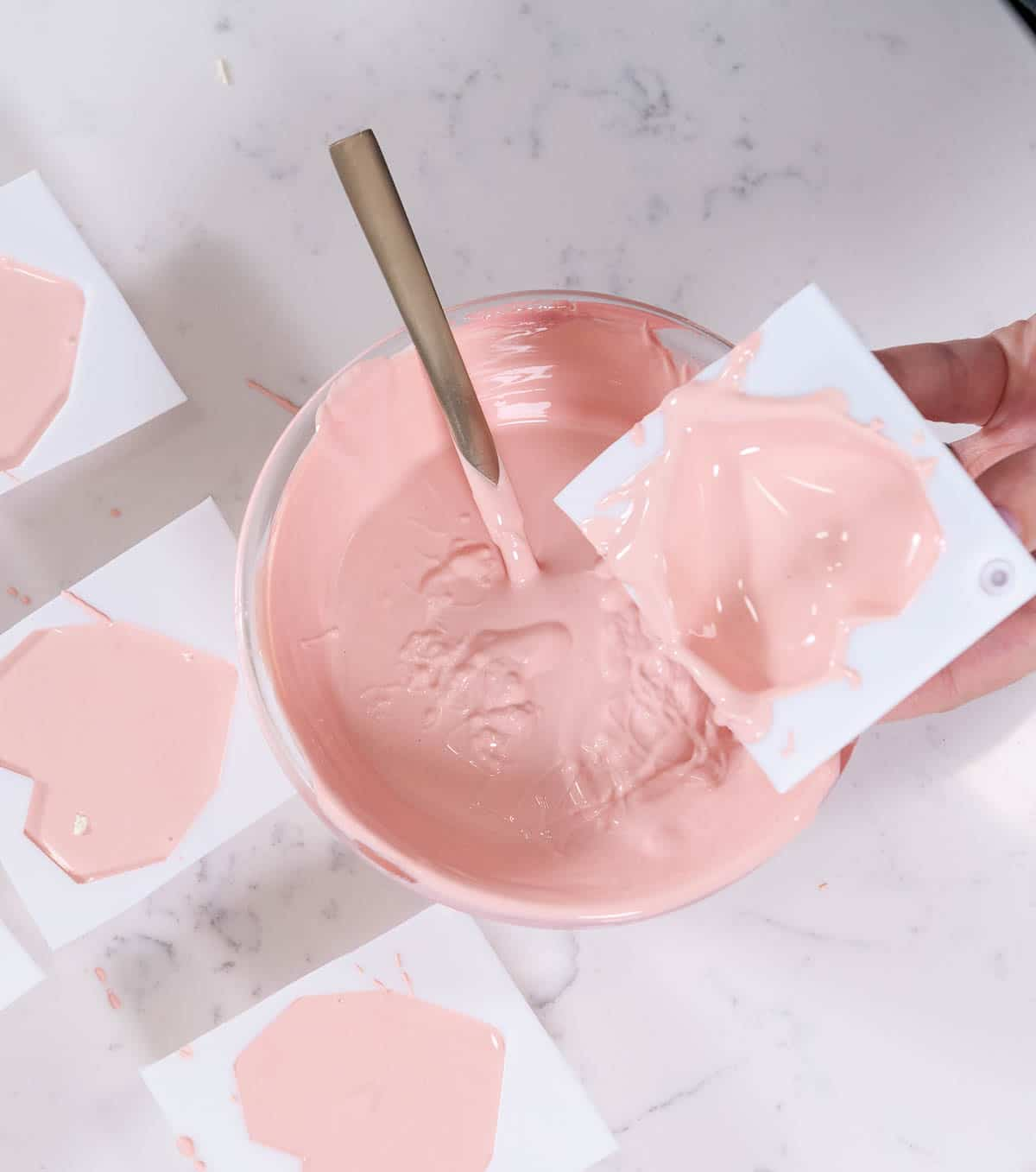 emptying heart hot chocolate molds over a pink bowl