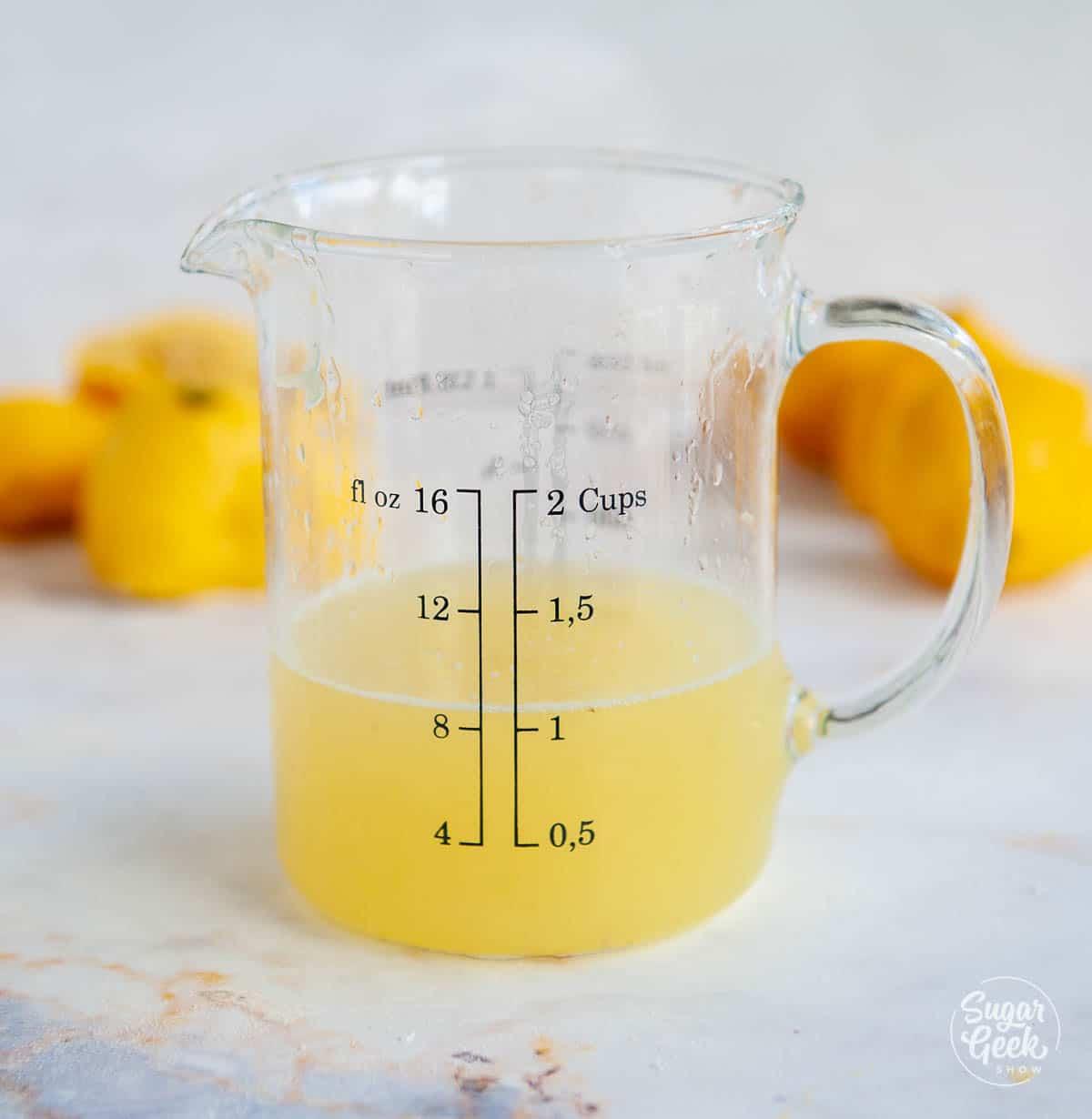 closeup of lemon juice in a measuring cup