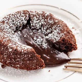 closeup of chocolate lava cake on a white plate