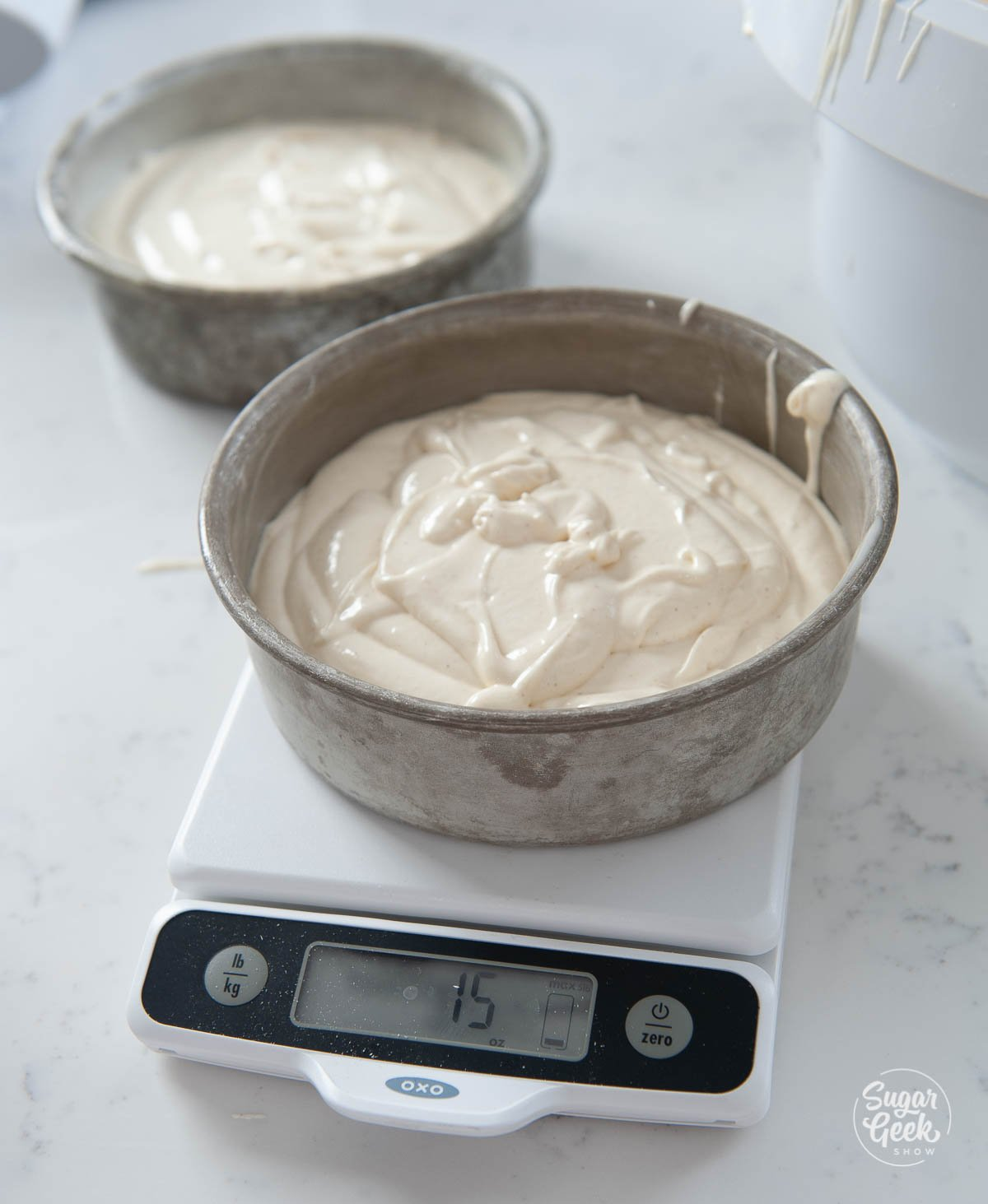 donut cake batter in a cake pan on a scale