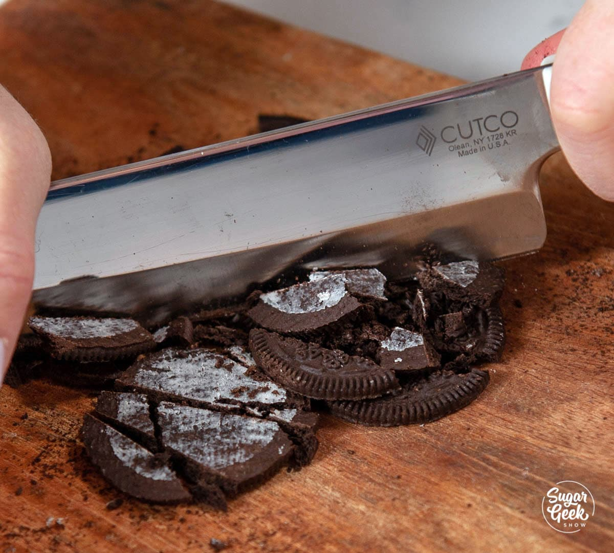 chopping Oreo cookies