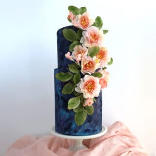Wafer paper roses arranged on a textured wedding cake