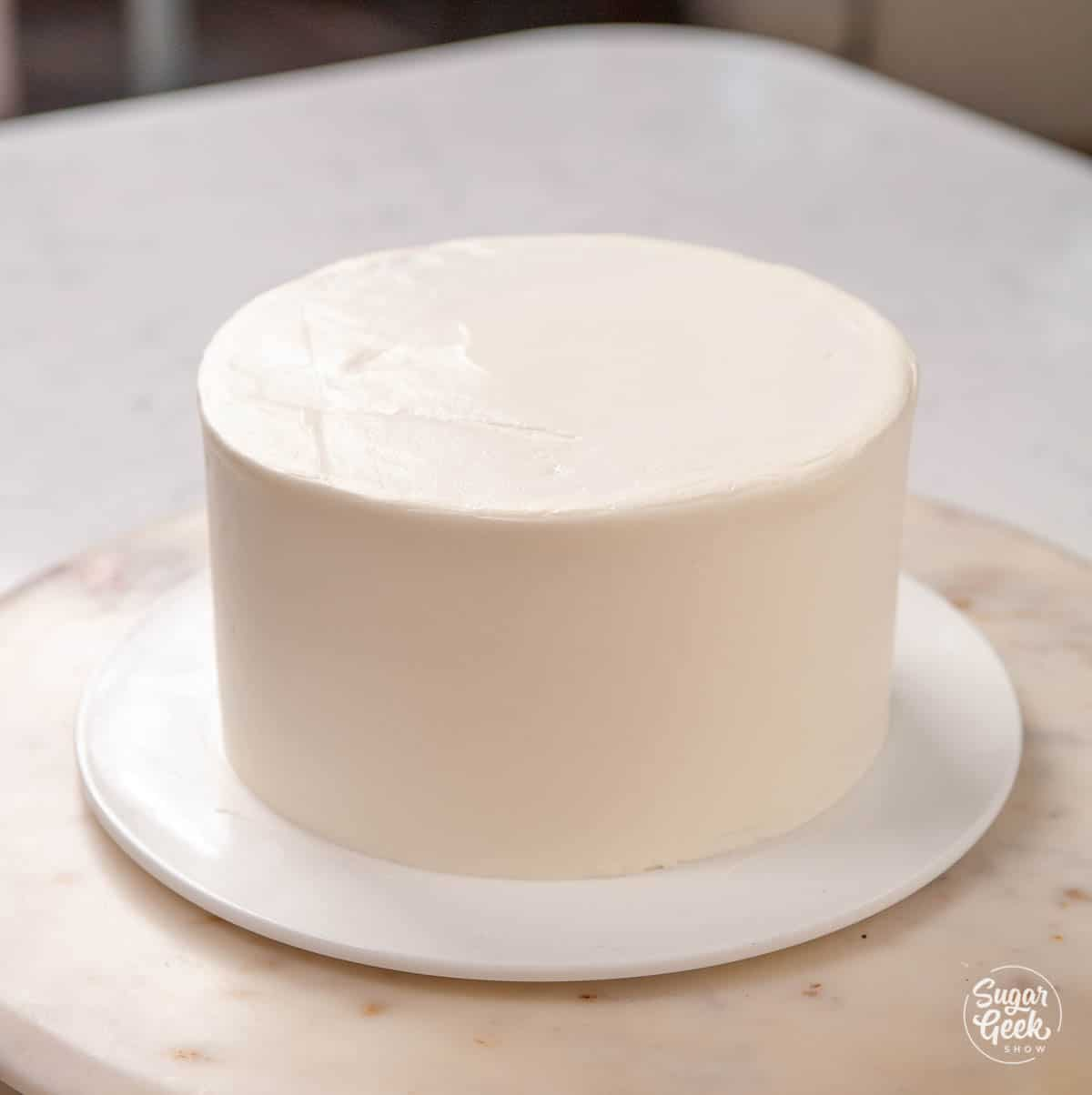 ice cream cake covered in whipped cream