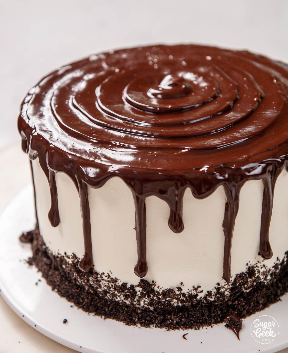 closeup of chocolate ganache drip on an ice cream cake