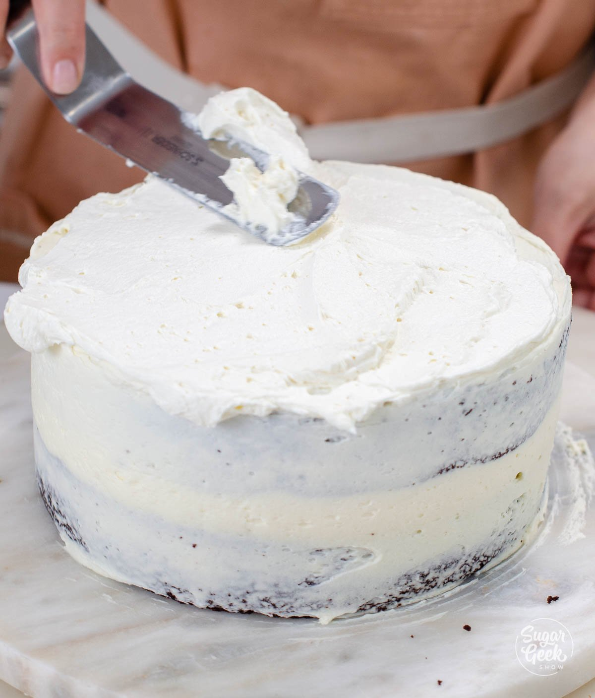 covering the cake in a thin layer of buttercream