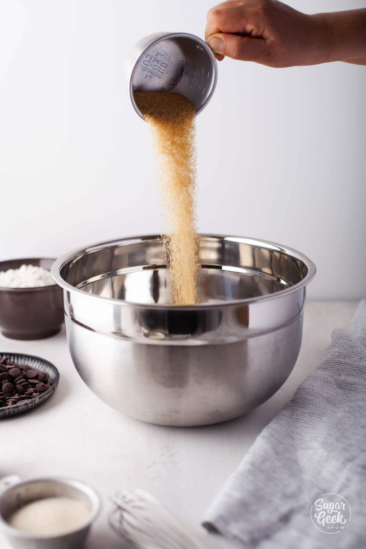 pouring brown sugar into a bowl