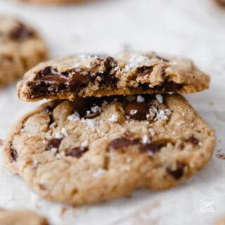 closeup of sea salt chocolate chip cookie on a white background