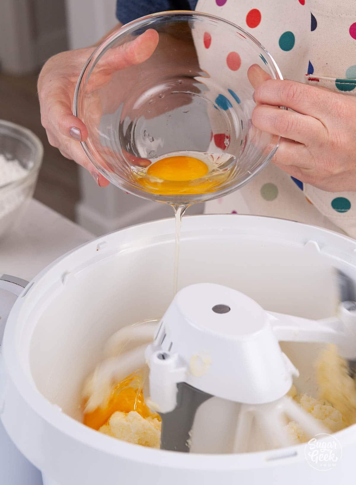 adding eggs to pound cake ingredients