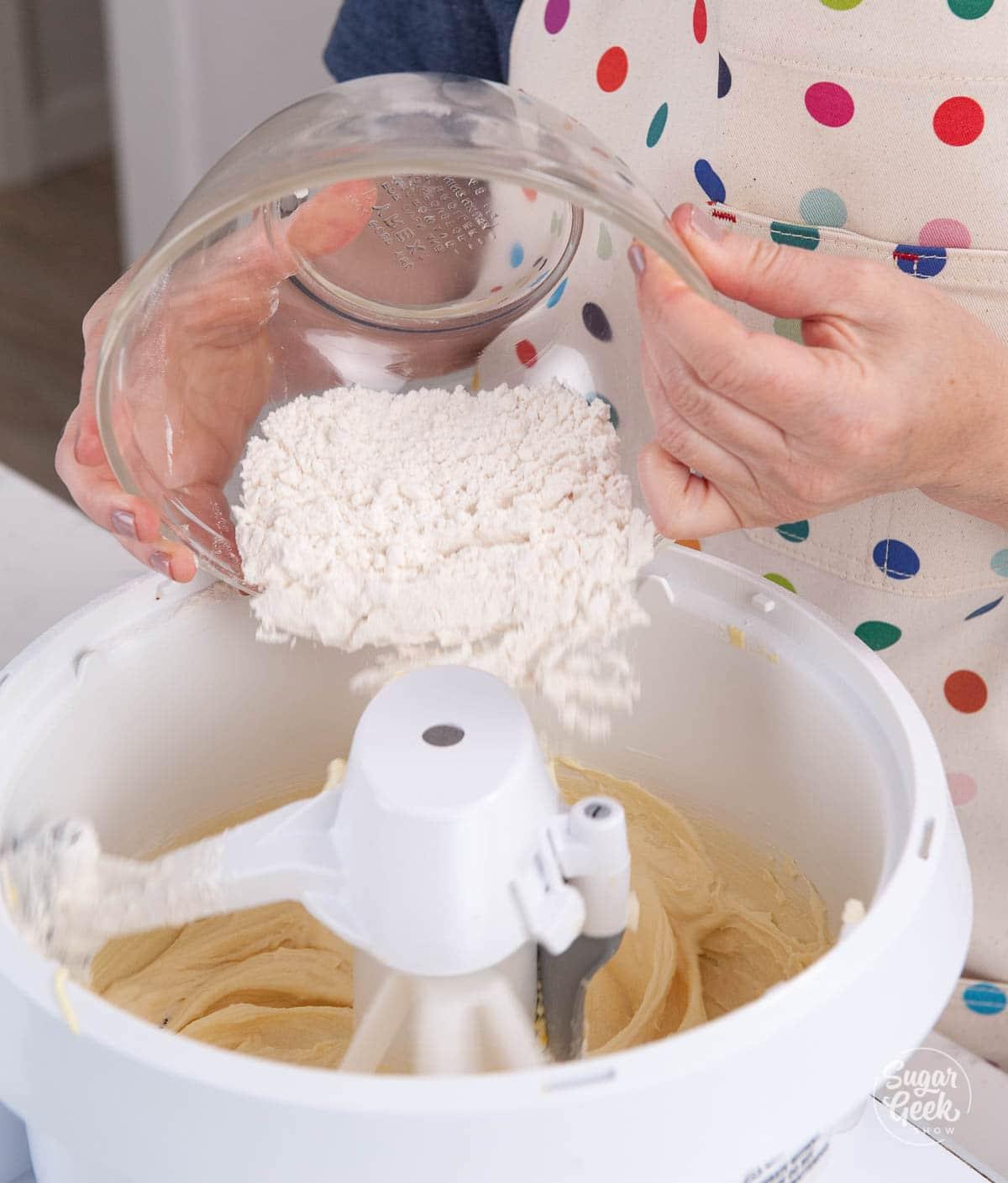 adding flour to pound cake mixture