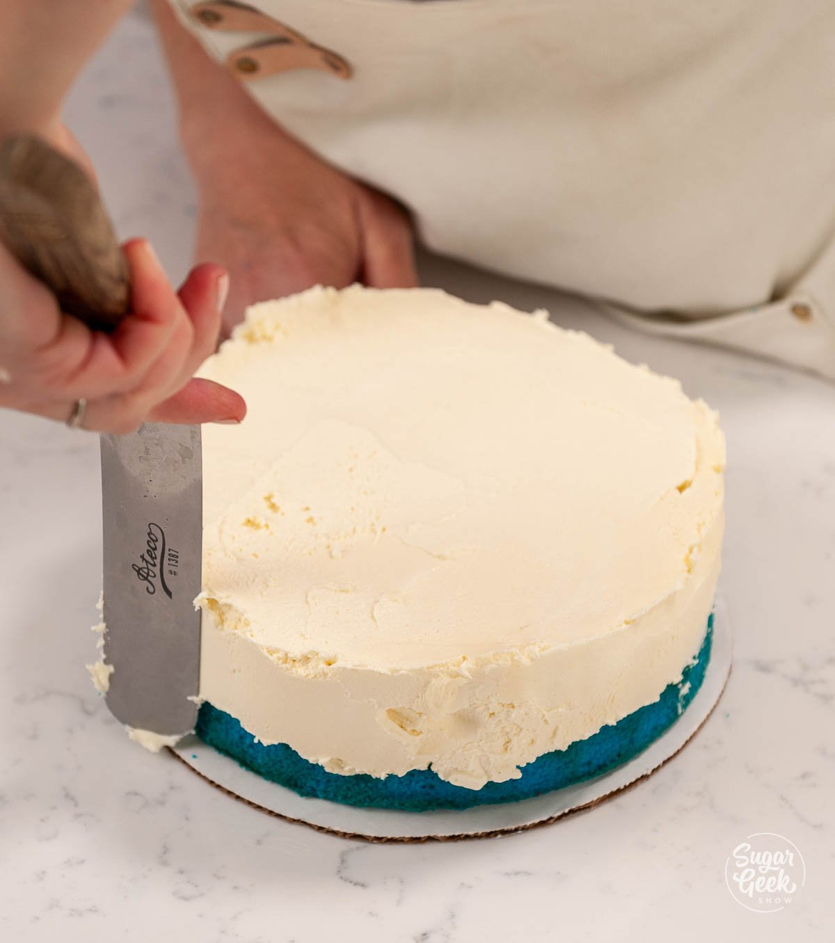 ice cream layer on top of blue cake layer