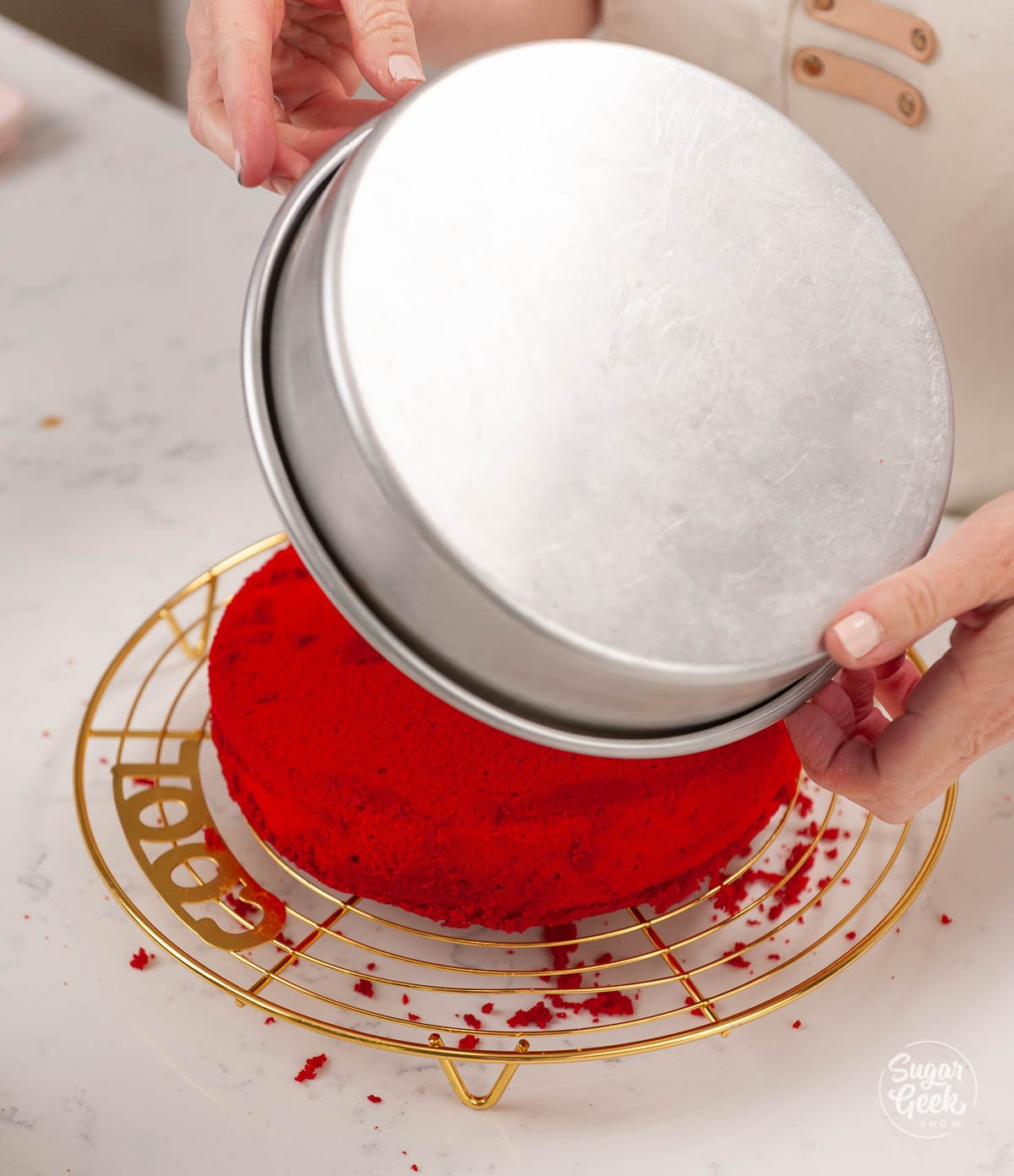 turning baked cake layers onto a cooling rack