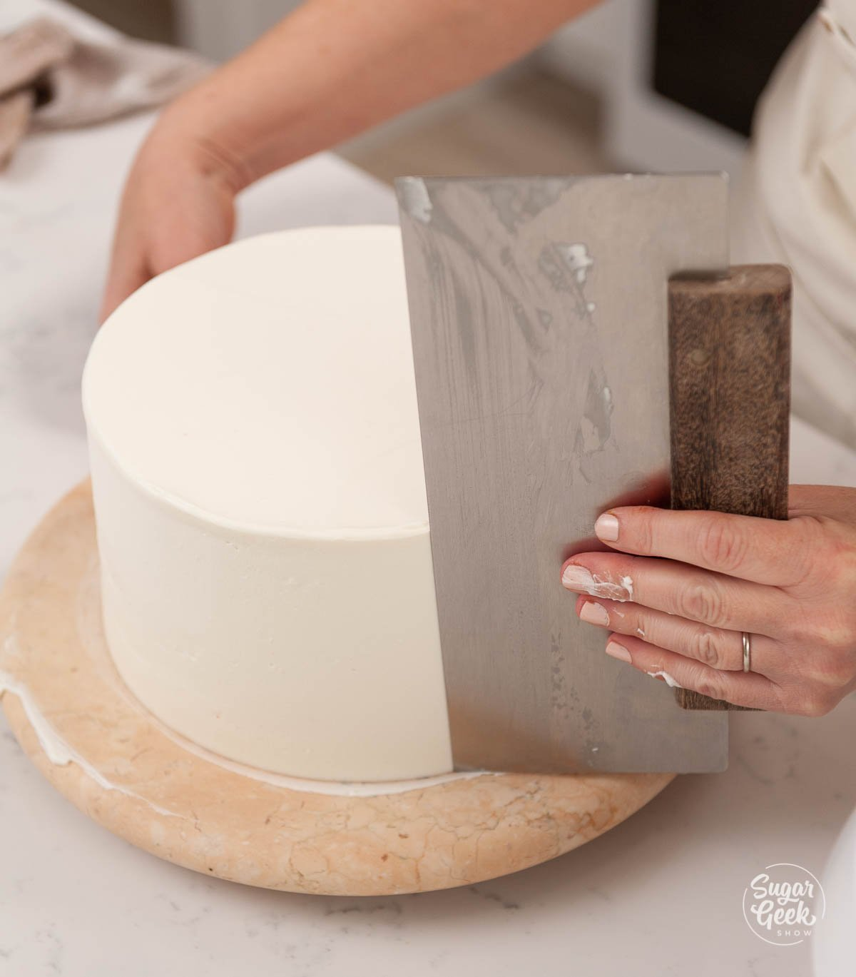 smoothing red white and blue ice cream cake with bench scraper