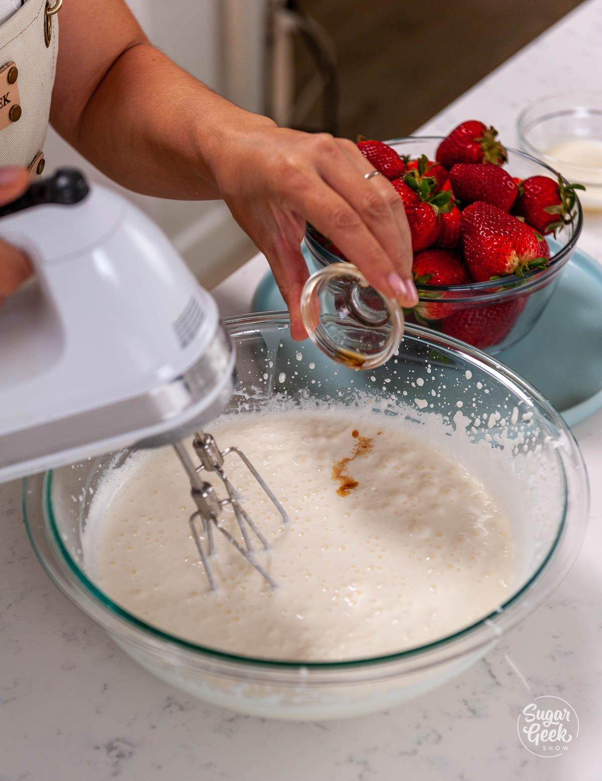adding vanilla to whipped cream mixture