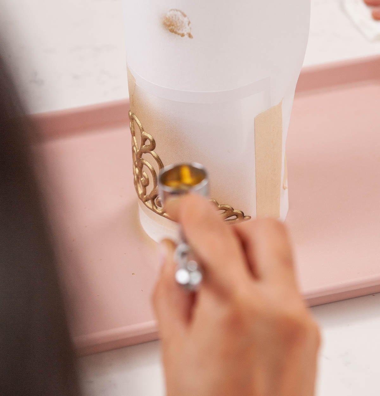 airbrushing a chocolate tiara gold