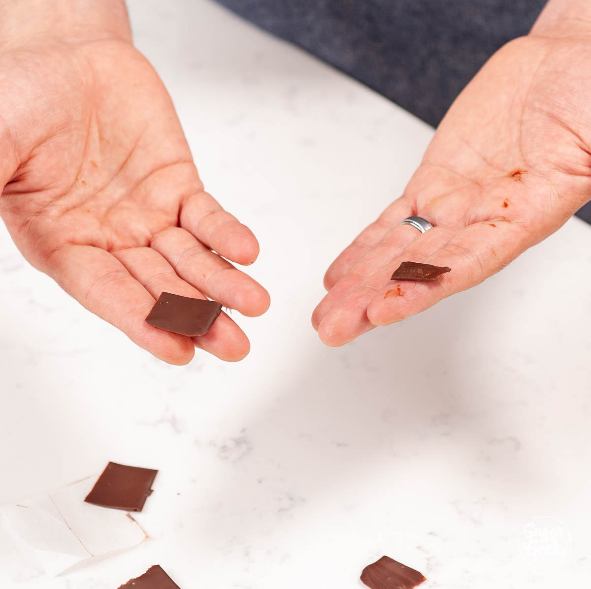 testing the temper of chocolate on parchment paper