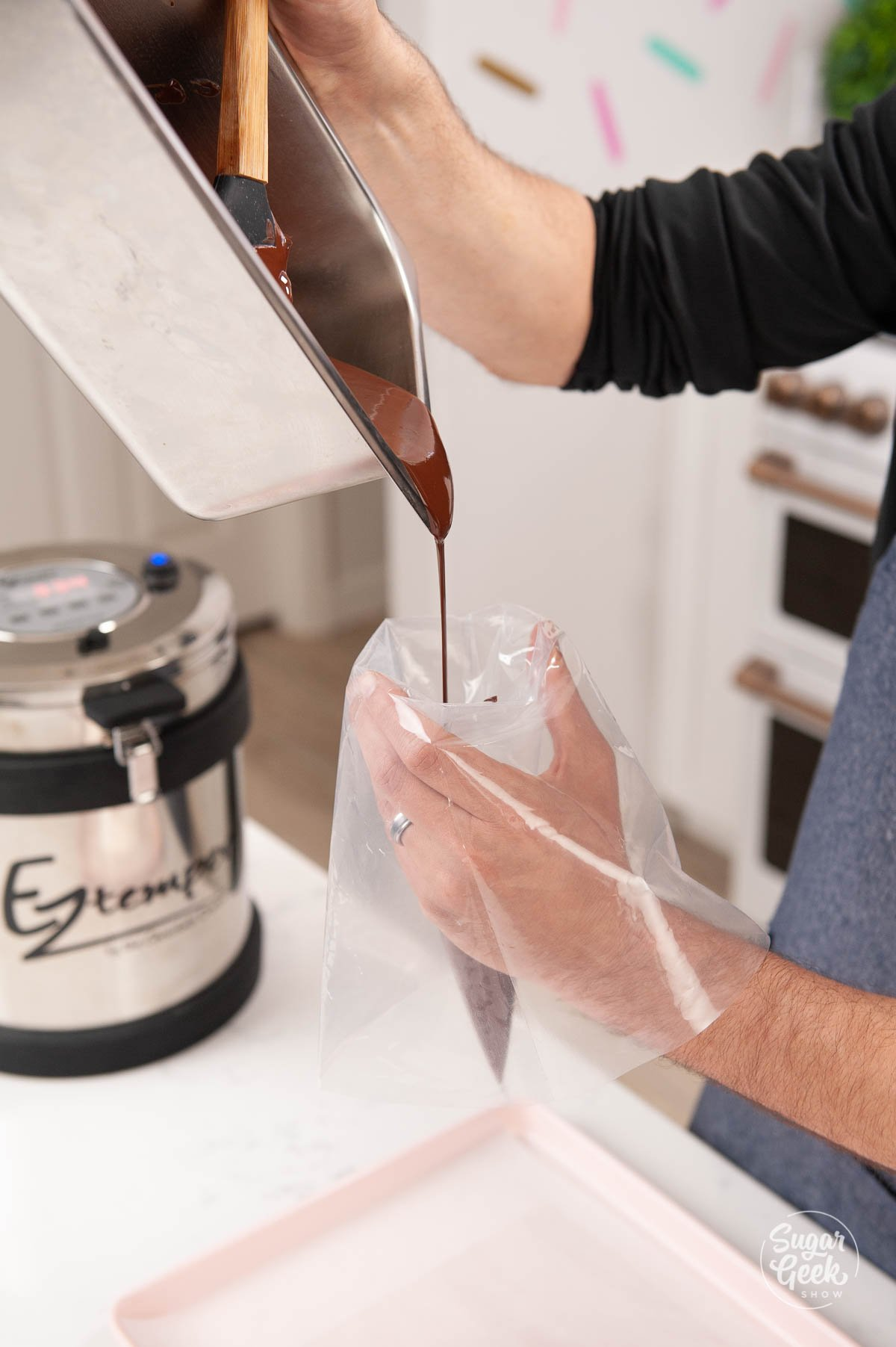 adding chocolate to a piping bag
