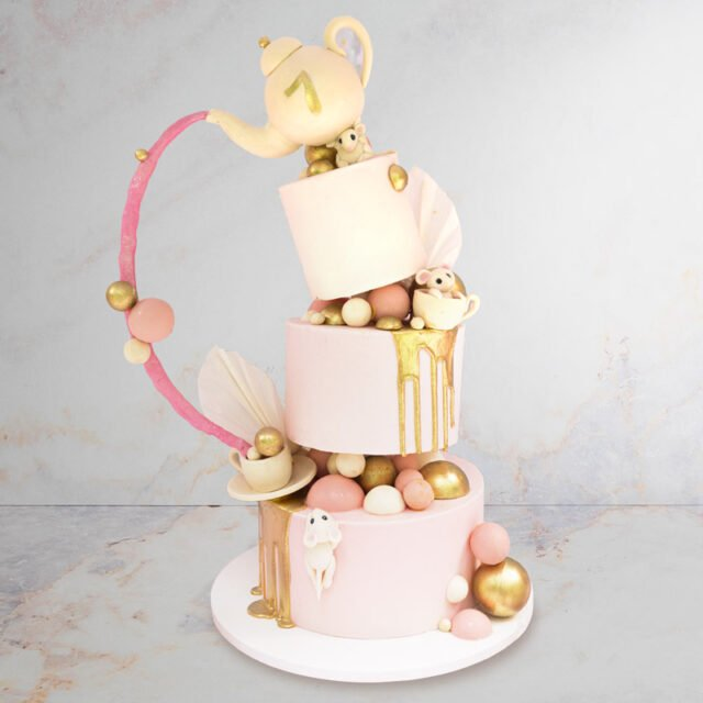 Topsy turvy Cake with teacups and mouses sculpted on it