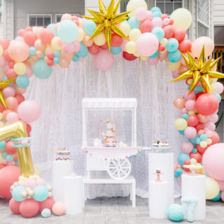 kittea party cake display with balloon arch