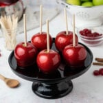 candy apples on a black platter