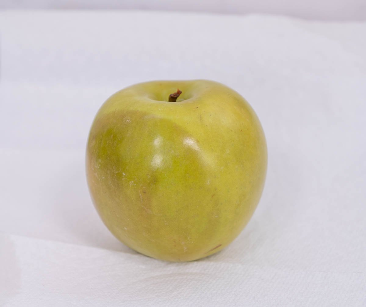 close up of green apple with brown skin