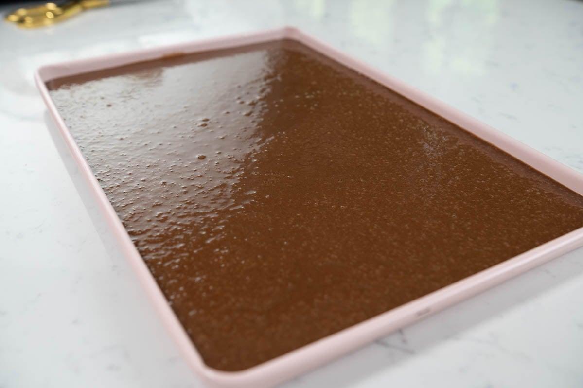 texas sheet cake batter in a sheet pan