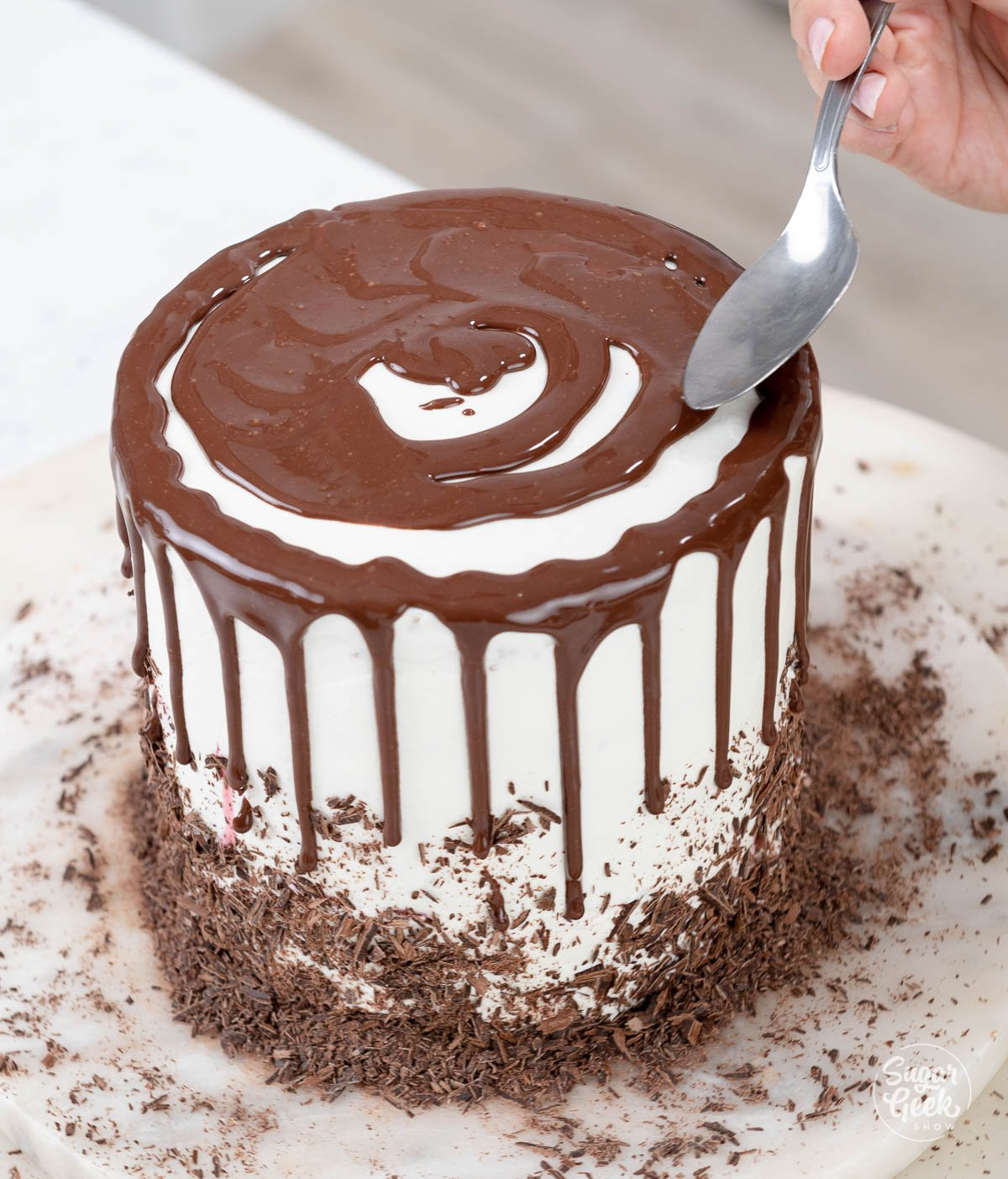 covering the cake with ganache