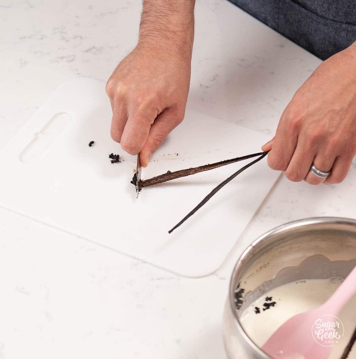 scraping vanilla seeds from a vanilla bean pod